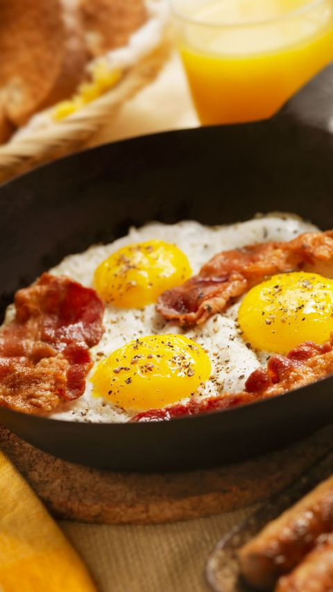 eggs and bacon cooking on stove