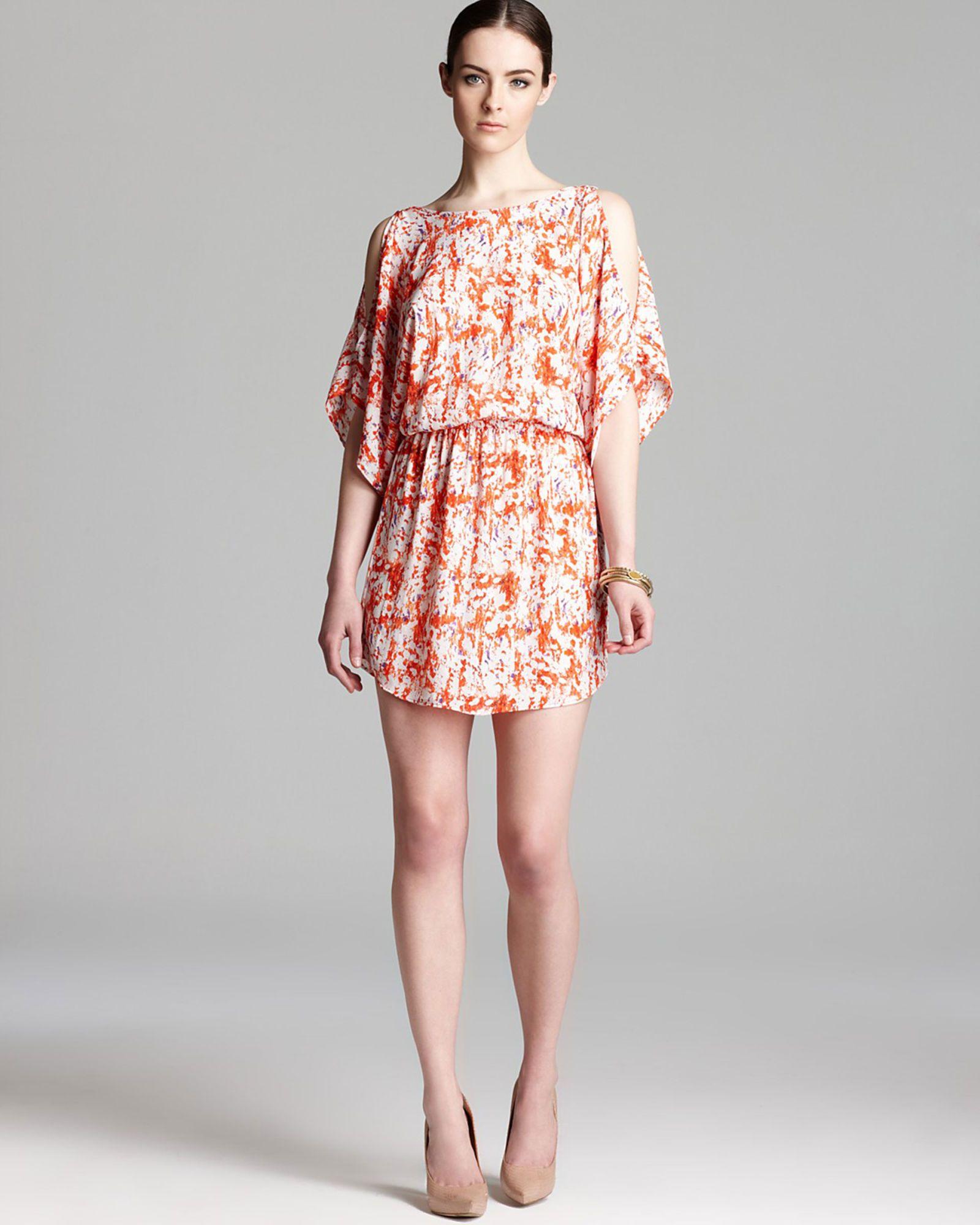 orange printed dress with slit shoulders