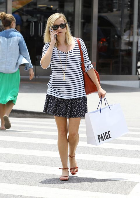 reese witherspoon wearing mixed printed top and skirt