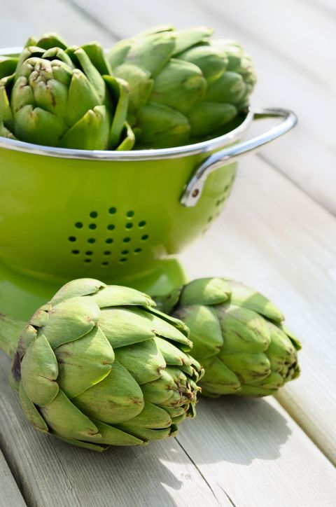 artichokes in a strainer