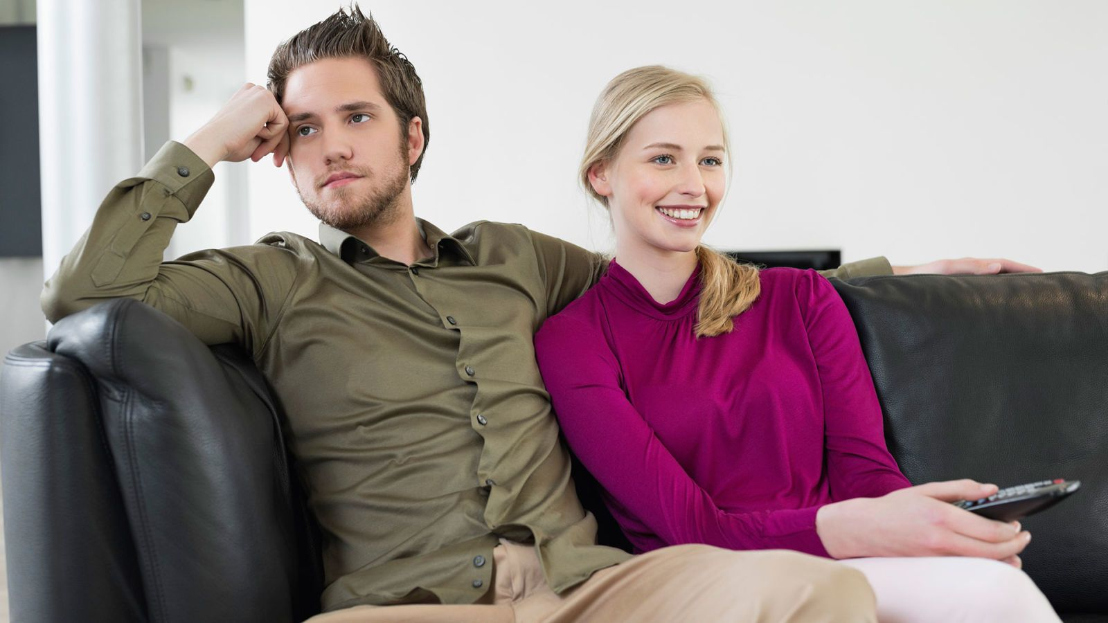 man and woman watching tv