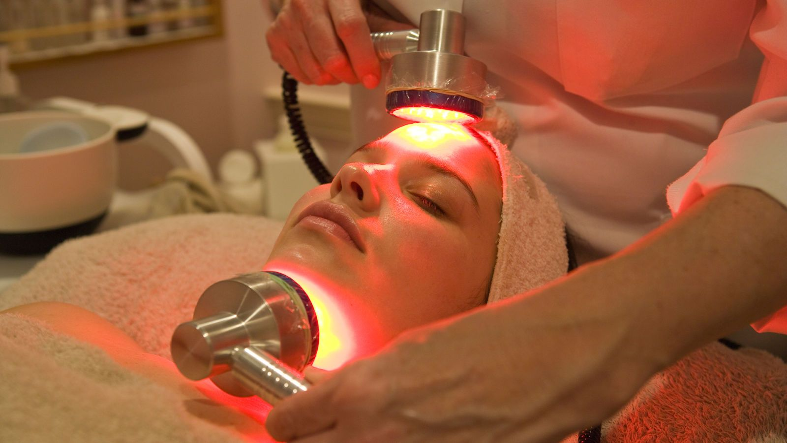 woman getting LED light therapy on face