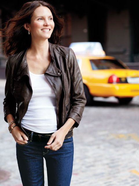 woman wearing leather jacket white tee shirt and jeans