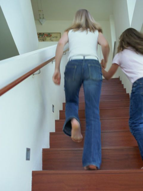 woman and girl running up the stairs
