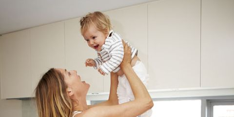 woman picking up a baby