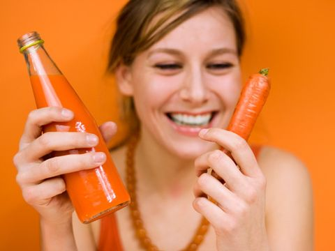 woman with carrot and carrot juice