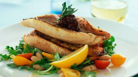 An open-faced fish sandwich