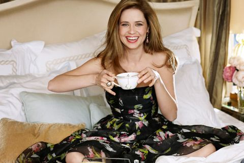 jenna in wearing dress in bed and drinking tea