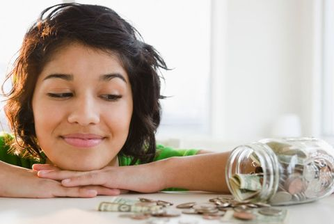 Woman with money jar