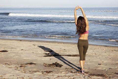 brooke burke stretching on beach