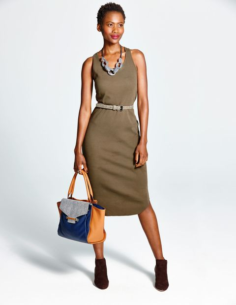 Clothing, Brown, Dress, Shoulder, Bag, Human leg, Joint, Standing, White, Style,