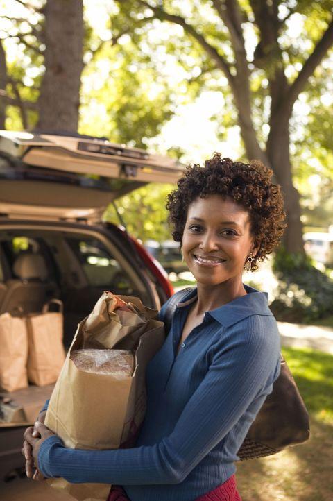 woman emptying shopping bags