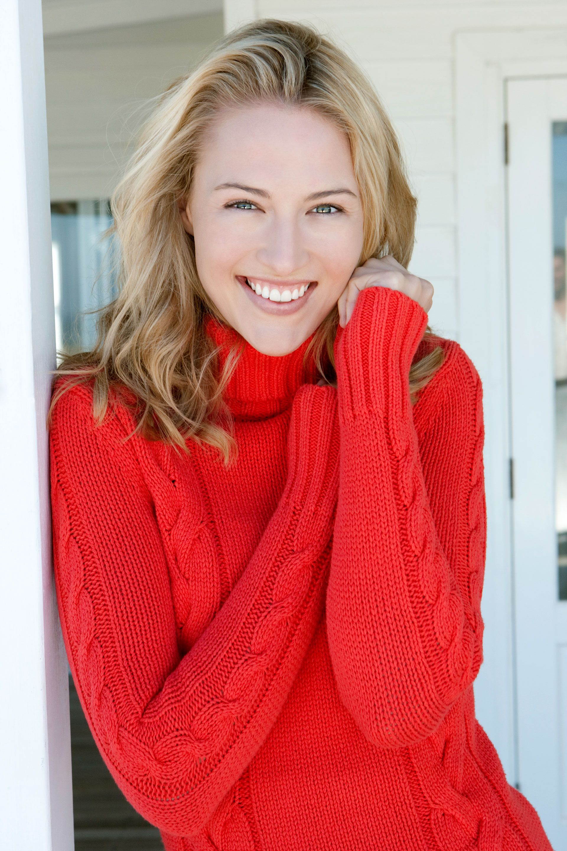 a woman in a bold red sweater