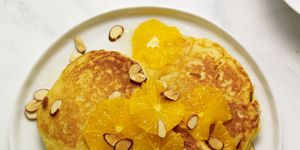 orange cornmeal pancakes with honey oranges and almonds