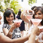 group of women enjoying cocktails