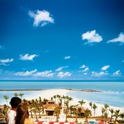 couple overlooking the cove atlantis resort pool