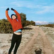 woman jumping on a hiking trail