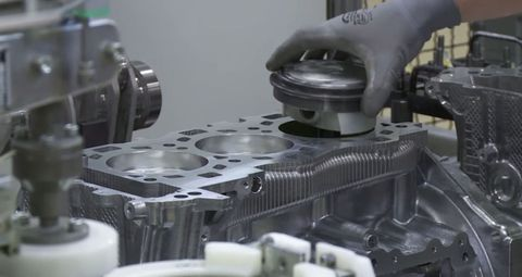 Watch Porsche's master mechanics hand-assemble 911 engines
