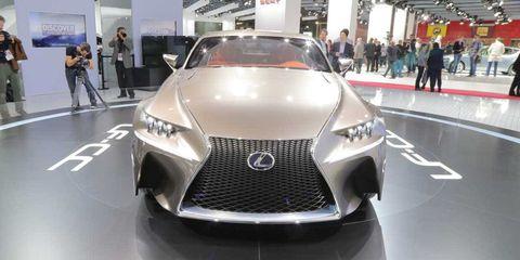Automotive design, Vehicle, Event, Land vehicle, Grille, Car, Personal luxury car, Luxury vehicle, Exhibition, Auto show,