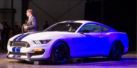 Tire, Wheel, Automotive design, Blue, Vehicle, Automotive tire, Land vehicle, Hood, Rim, Grille,