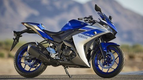 Motorcycle, Tire, Wheel, Motor vehicle, Automotive tire, Mode of transport, Blue, Automotive design, Transport, Fuel tank,