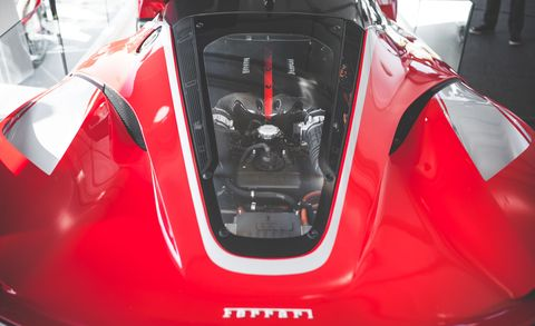 Automotive design, Red, Glass, Sports car, Hood, Supercar, Performance car, Windshield, Race car, Automotive window part,