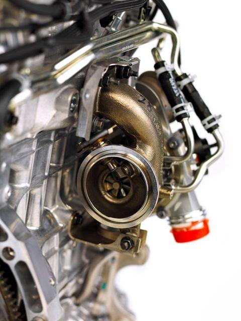 Motorcycle accessories, Automotive engine part, Engine, Machine, Metal, Auto part, Transmission part, Nut, Automotive engine timing part, Silver,