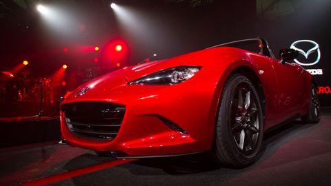 Automotive design, Vehicle, Event, Land vehicle, Automotive lighting, Car, Red, Performance car, Headlamp, Fender,