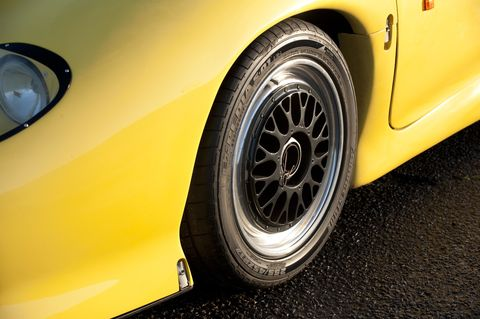 Tire, Wheel, Automotive tire, Automotive design, Automotive exterior, Alloy wheel, Yellow, Vehicle, Automotive wheel system, Rim,