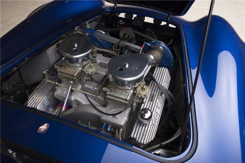 Motor vehicle, Blue, Automotive design, Engine, Automotive exterior, Electric blue, Automotive engine part, Hood, Cobalt blue, Grille,