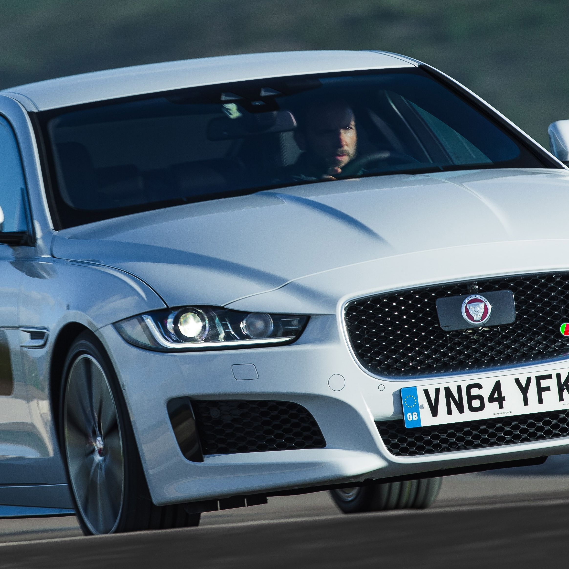 The XE is sized within 2 inches of the BMW 3-Series in every external dimension but feels slightly smaller inside. It's 1.5 inches wider and 0.6 inch lower, though, and with its wheels pushed right to the outside, it looks low and sturdy on the road.