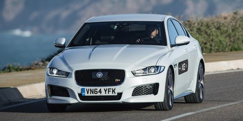 """Jaguar's saying we'll see our first XEs on sale in """"spring 2016,"""" almost a year behind the rest of the world. Reason for the delay: JLR doesn't want the car on sale until the all-wheel-drive model is available. Its development isn't finished yet."""