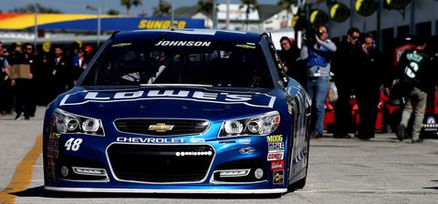 DAYTONA BEACH, FL - FEBRUARY 14: Jimmie Johnson, driver of the #48 Lowe's Chevrolet, drives through the garage area during practice for the 57th Annual Daytona 500 at Daytona International Speedway on February 14, 2015 in Daytona Beach, Florida.  (Photo by Sean Gardner/NASCAR via Getty Images)