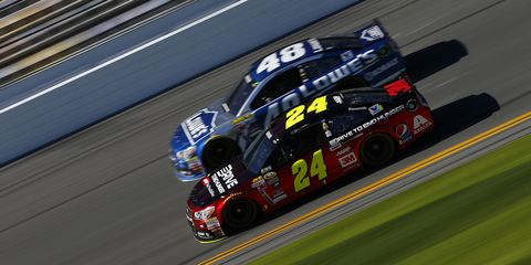 DAYTONA BEACH, FL - FEBRUARY 18:  Jeff Gordon, driver of the #24 Drive To End Hunger Chevrolet, and Jimmie Johnson, driver of the #48 Lowe's Chevrolet, practice for the 57th Annual Daytona 500 at Daytona International Speedway on February 18, 2015 in Daytona Beach, Florida.  (Photo by Jonathan Ferrey/NASCAR via Getty Images)