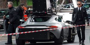 Daniel Craig as James Bond with the Aston Martin movie car from Spectre