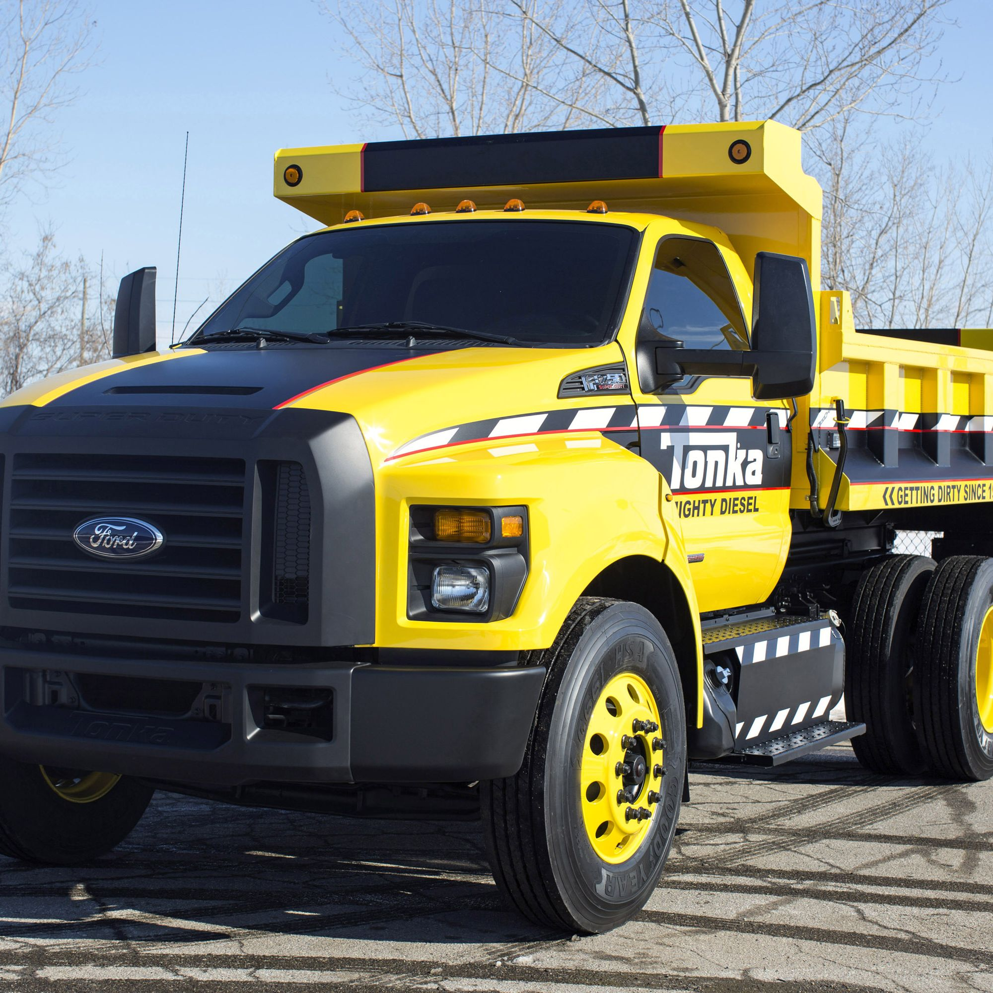 Based on the all-new 2016 Ford F-650/F-750, the Mighty F-750 TONKA dump truck is is painted signature TONKA yellow with a custom blackout nostril grille and fully functional dump body from Truck Tech Engineers.