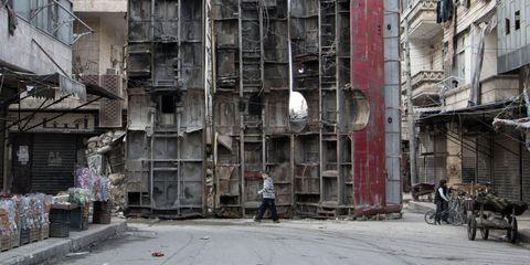 Aleppo, Syria bus bodies vertically arranged as a sniper barrier.