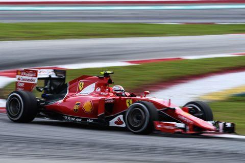 kimi raikkonen races through a corner during the formula one malaysian grand prix in sepang