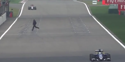 F1 fan crosses track at Chinese Grand Prix