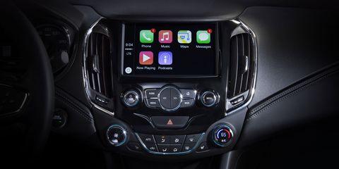 Vehicle audio, Luxury vehicle, Automotive light bulb, Center console, Personal luxury car, Machine, Multimedia, Display device, Gear shift, Sports car,