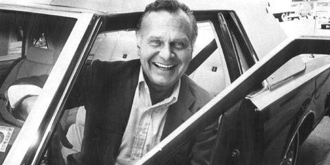 Motor vehicle, Vehicle door, Windshield, Automotive window part, White-collar worker, Car seat, Classic car, Hardtop, Portrait, Vintage car,