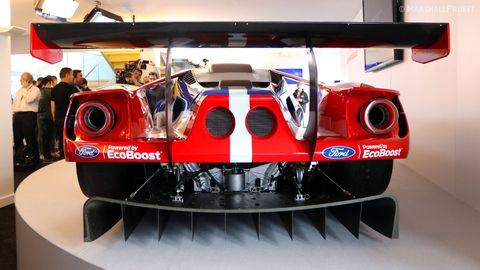 Automotive design, Red, Logo, Machine, Gas, Design, Engineering, Umbrella, Steel, Exhibition,
