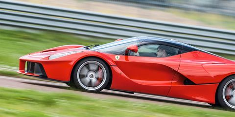 Wheel, Mode of transport, Automotive design, Vehicle, Transport, Car, Supercar, Automotive exterior, Red, Sports car,