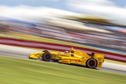 Tire, Wheel, Automotive tire, Automotive design, Yellow, Vehicle, Race track, Motorsport, Formula one tyres, Car,