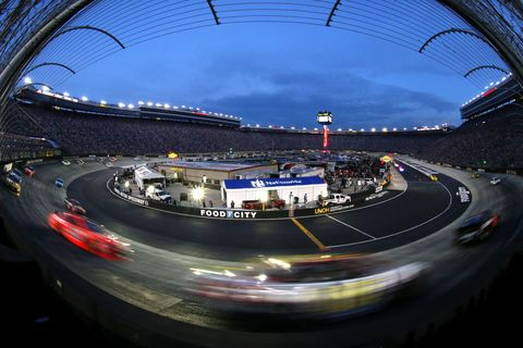 Road, Infrastructure, Sport venue, Race track, Automotive lighting, Arch, Landmark, Asphalt, Metropolitan area, Racing,
