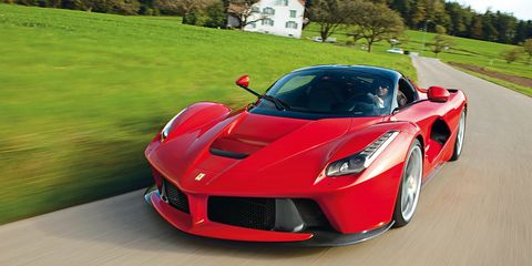"""<p>Ferrari's current halo car uses an advanced hybrid HY-KERS system, which means that the electric motor (160 bhp) generates low end power. At the higher revs, the combustion engine (789 bhp) takes over. This is so that the high-revving V12 engine would not sacrifice low-end power, as low RPM torque is provided by the electric motor. The LaFerrari has an all-electric driving mode, albeit with a <a href=""""http://autoweek.com/article/car-news/laferraris-all-electric-mode-has-never-been-secret"""" target=""""_blank"""">very short range</a>, and uses regenerative braking to charge the electric motor when not plugged in.</p>"""