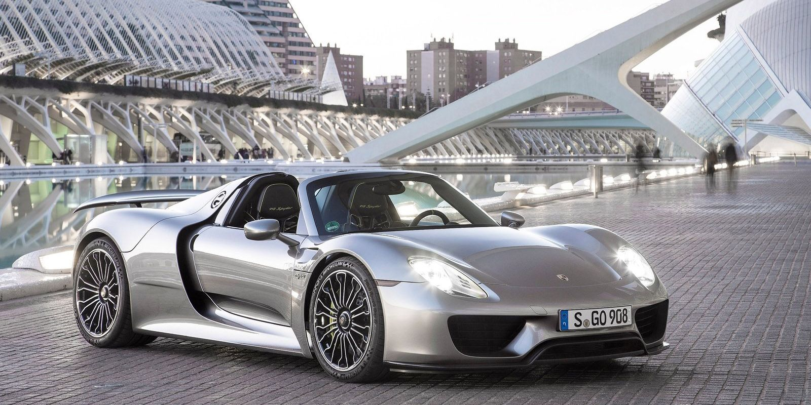 With 608 gas-powered bhp turning the rear wheels and 279 electric bhp turning the front, the 918 Spyder is a four-wheel-drive 887 bhp supercar. The electric motor has a range of 12 miles and can be charged via engine power, regenerative braking, or charging station.