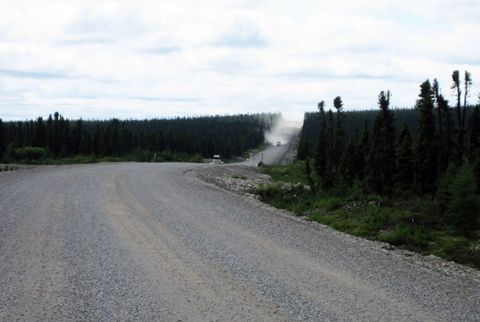"""<p><span style=""""font-size:11pt;""""><strong>Distinction:</strong></span> Closest you can drive to Greenland, but watch out for the spring snowmelt</p><p>The Canadian town of Goose Bay, Labrador, is closer to Ireland than it is to Colorado, and there is just one road connecting the rest of North America to the small town of 800 people: Route 500, the Trans-Labrador Highway. A civilian airport and a Canadian Air Forces Command were built out here just after World War II, and laid the foundation for the construction of the highway. </p><p>Route 500 starts at Newfoundland and Labrador's provincial border with Quebec, winds through the small town of Labrador City. The road spans 315 miles from Labrador City to Goose Bay and is all gravel. The wide, smooth gravel splits rolling hills covered with tall pines. And despite the large trucks that bring supplies and equipment for the hydroelectric industry, the road surface remains smooth and well-maintained. </p><p>In the spring, however, massive snowmelt runoff washes the highway away in many places, making the trip to Goose Bay treacherous. Traveling east toward Goose Bay one spring, the runoff washed the road out behind us. About five miles later, the road was washed out ahead of us. Only a quick fording of the washout behind us to our west prevented us from being stranded 150 miles from either Goose Bay to the east and Churchill Falls to the west. We stopped a sheriff in Labrador City to ask road conditions on our trip east to Goose Bay, and he said he wouldn't recommend the trip, but that we were free to try the drive at our own peril. </p><p>Since then, the Canadian government began a program of loaning satellite phones to motorists making the trip—there are no cellphone towers along Route 500.</p>"""