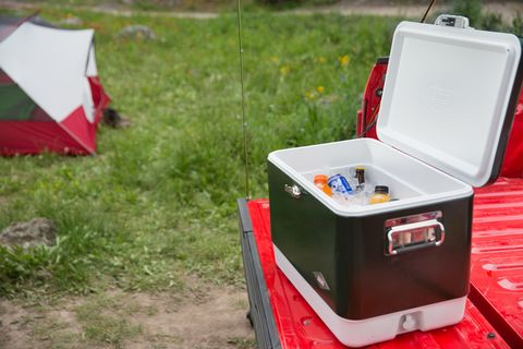 "<p>At the top of every list for campers arriving on four wheels has to be a sturdy cooler. And few names ring more true in the world of coolers than Coleman. We  went with the retro styled <a href=""http://www.coleman.com/product/54-quart-steel-beltedreg-cooler-green/3000003096?contextCategory=8501#.VeicXLxVhBd"" target=""_blank"">Steel Belted Cooler</a> in classic green. The metal case increases durability and offers an easy to clean surface for everything from playing cards to cleaning a fish.</p><p>$150 from <a href=""http://www.coleman.com/Home"" target=""_blank"">Coleman</a></p>"