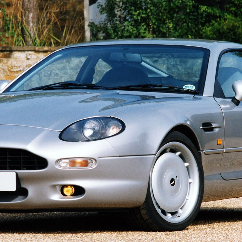 "<p>The British carmaker kept up appearances with this c<a href=""http://www.caranddriver.com/comparisons/aston-martin-db7-vantage-vs-porsche-911-turbo-ferrari-360-modena-f1-comparison-tests"">lassically proportioned coupe</a>.</p>"